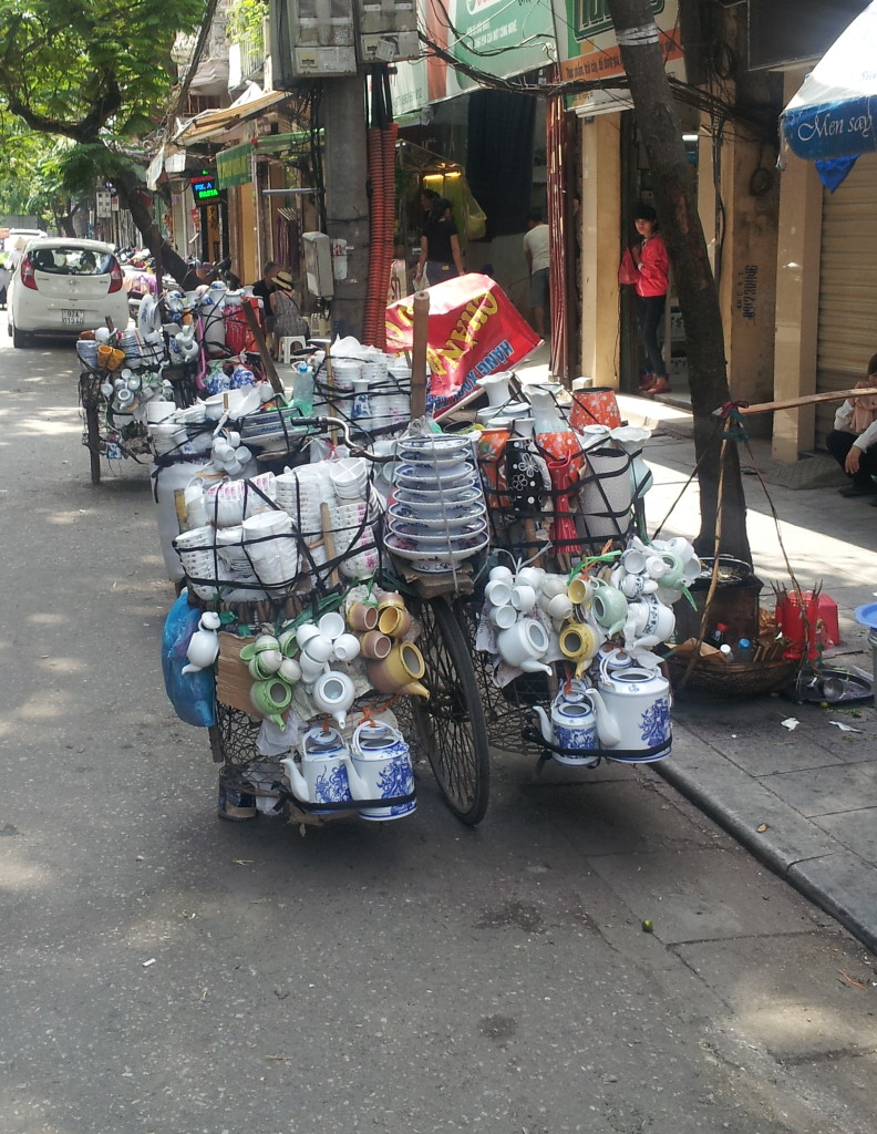 Not a moped, but a bike full of china is pretty cool anyway